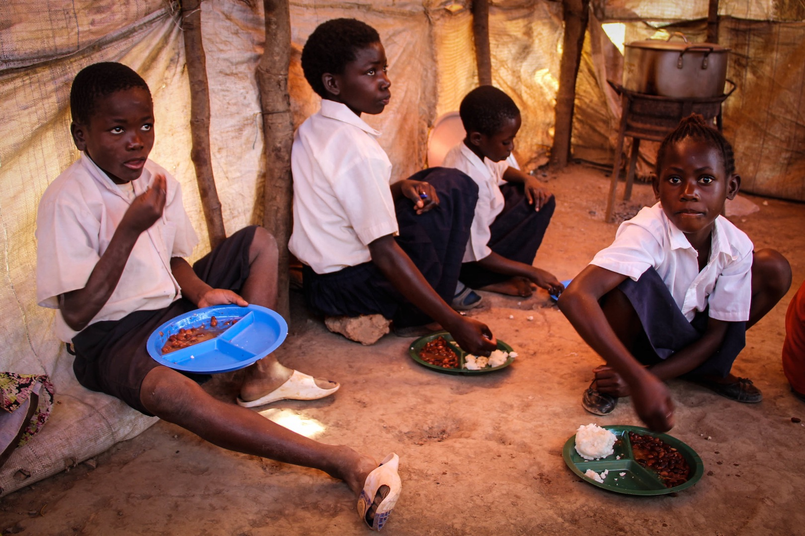 Children receive their daily nutritious meal cooked by volunteer Care Workers