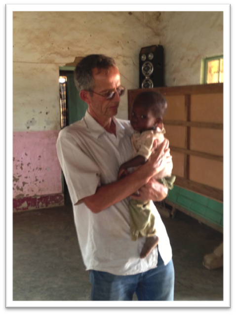 George with a child in Kambove, Democratic Republic of Congo