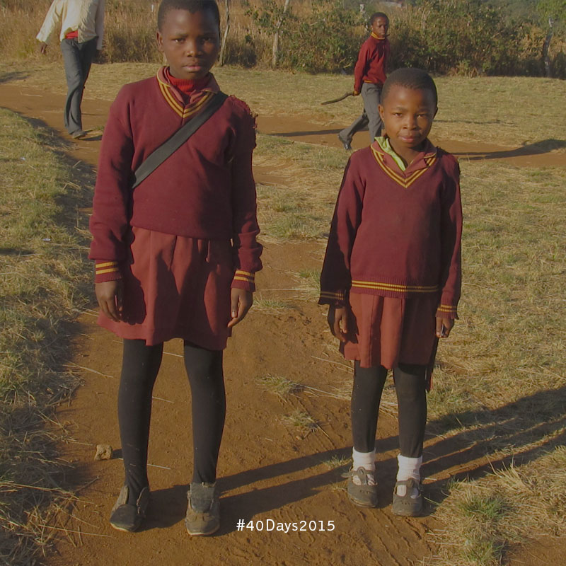 Two young girls on their way to school in Swaziland
