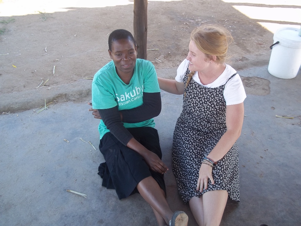 Jade with a volunteer Care Worker from the local church in Zimbabwe