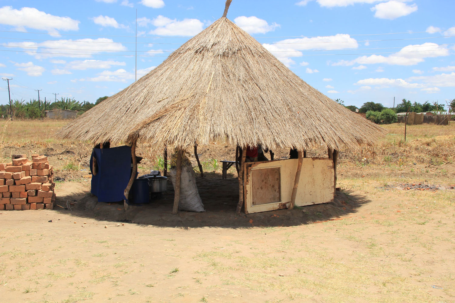 This thatched hut is used for cooking and storage in Chisamba community.