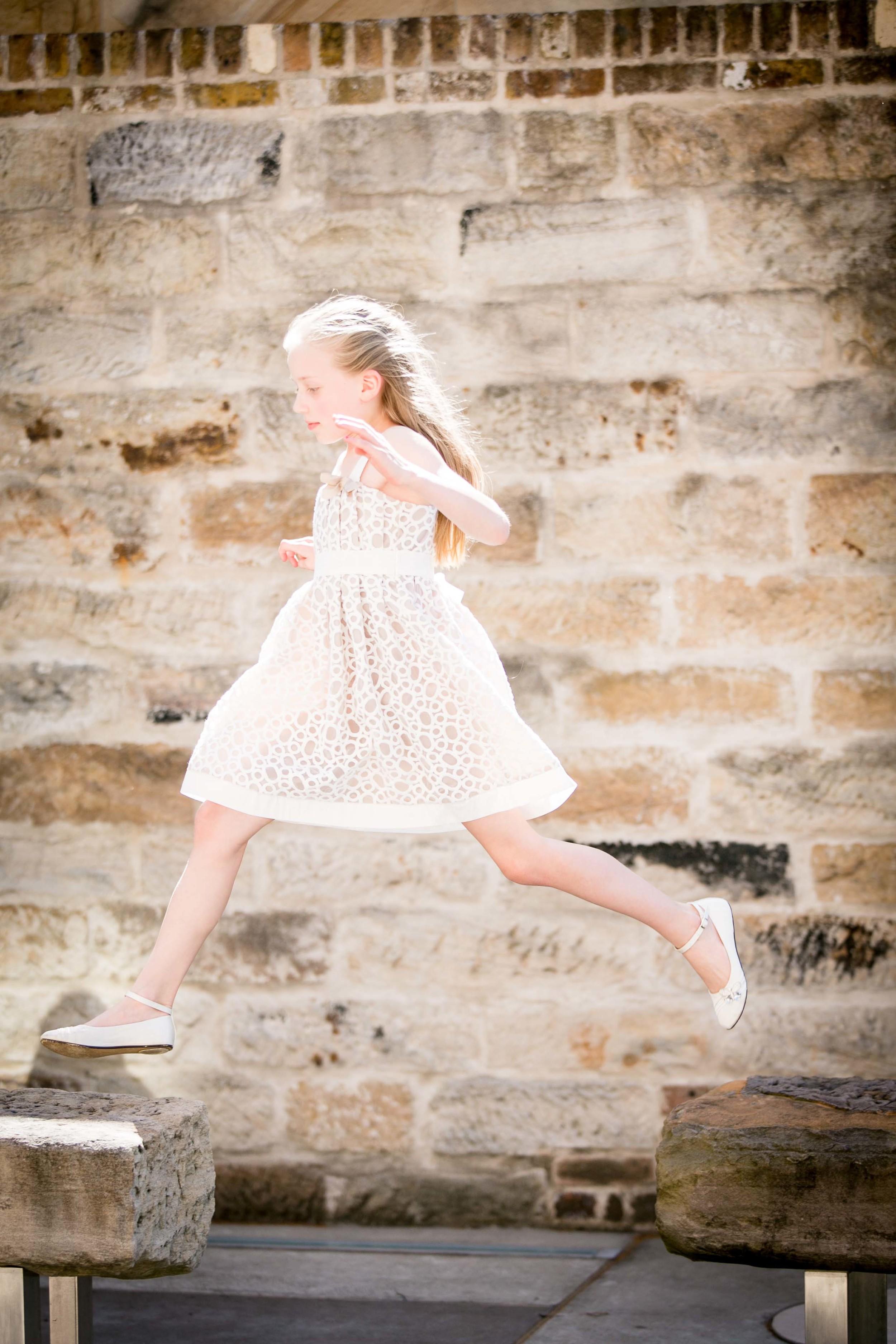 Emily and Stewart wedding St Brigid Sydney Girl Jumping