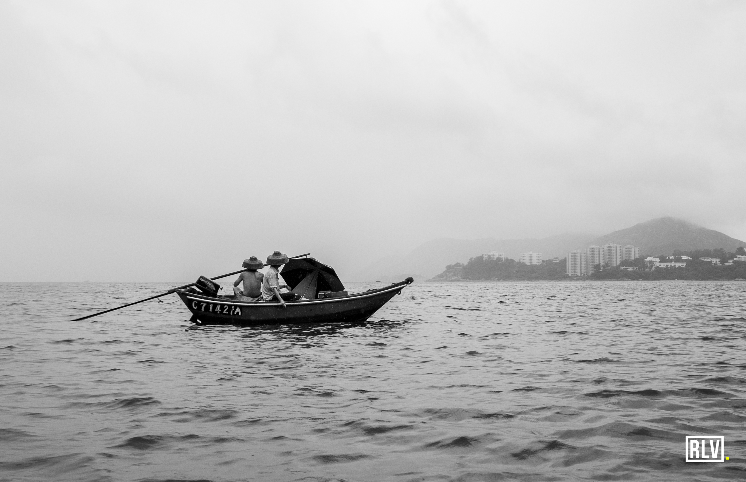 One of my favourite photos from the water. Local fishermen battling the wet and wild conditions off from Stanley beach
