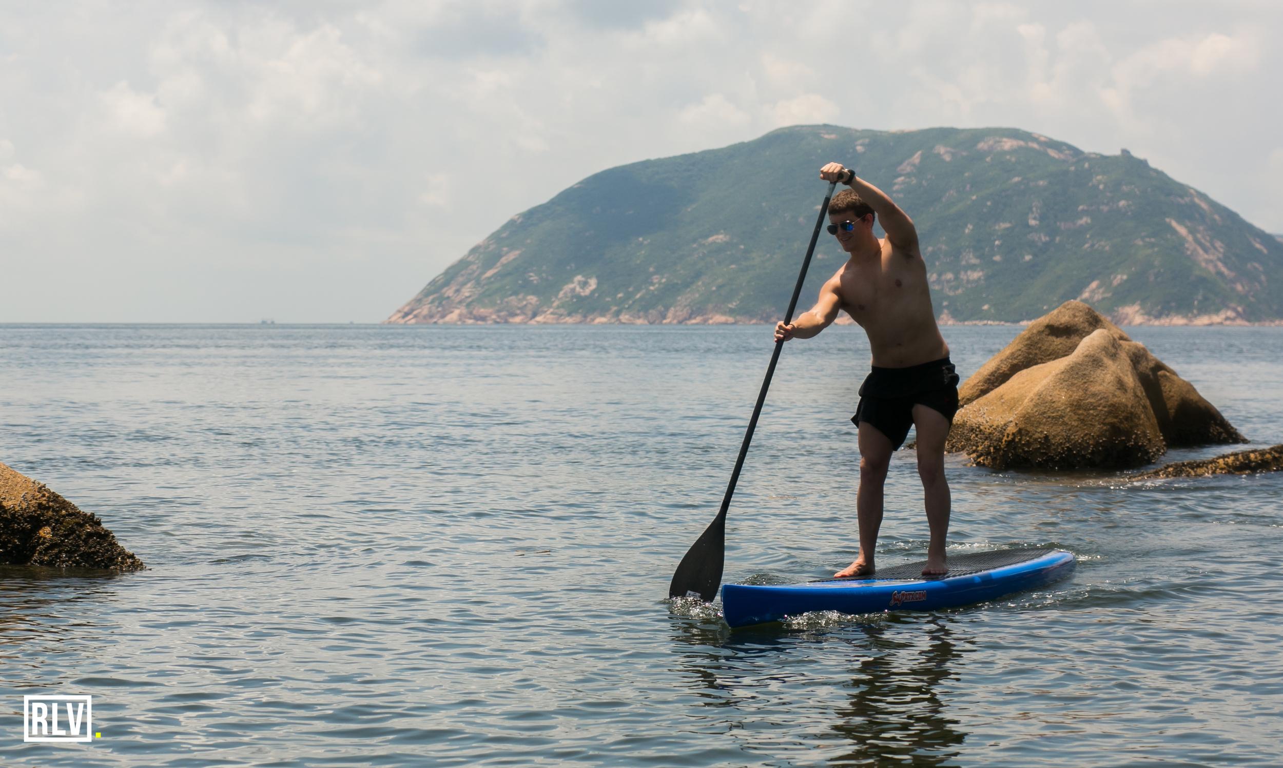 Steve West navigating over some shallow rocks.