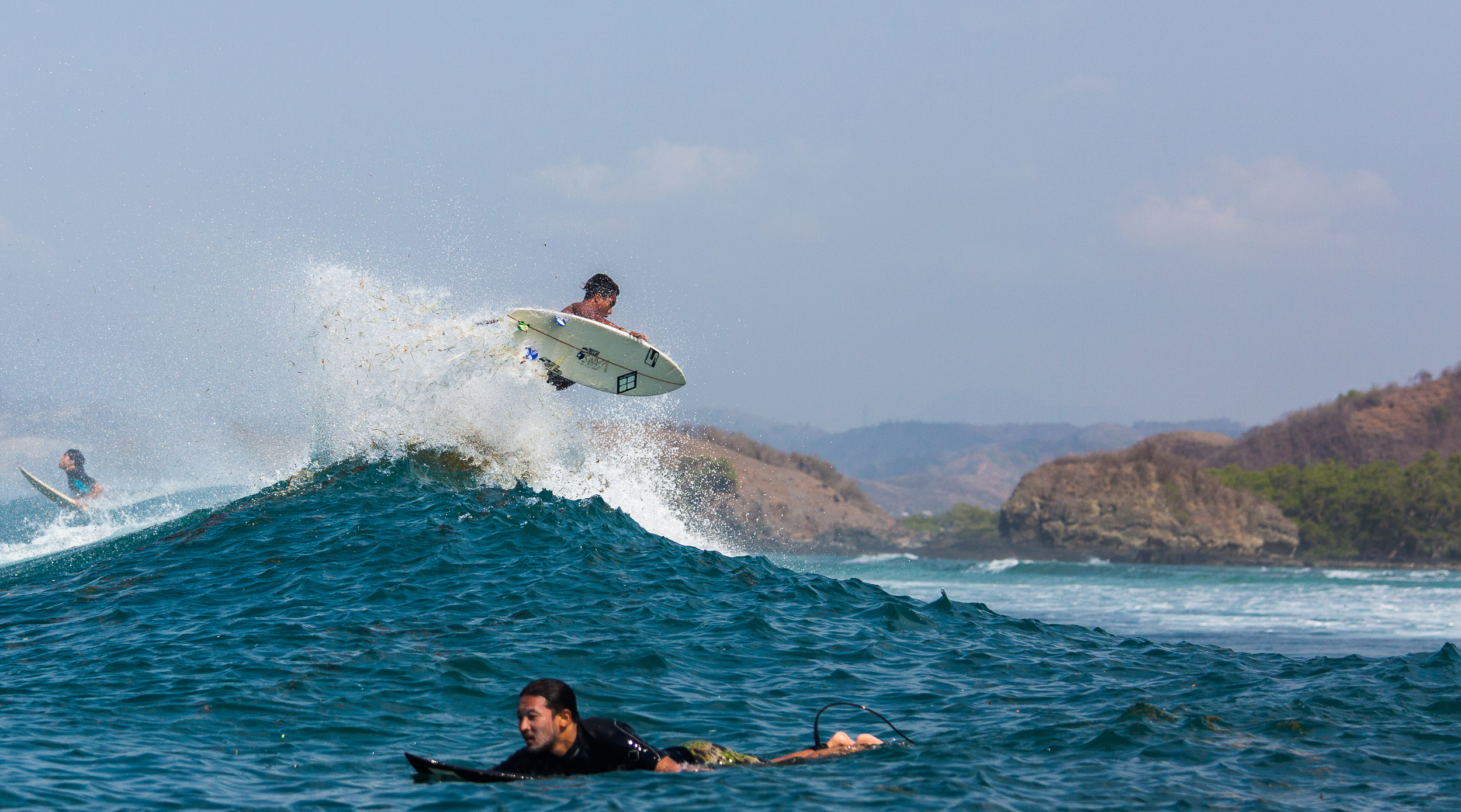 Local finding space in-between the crowds to punt an air reverse.