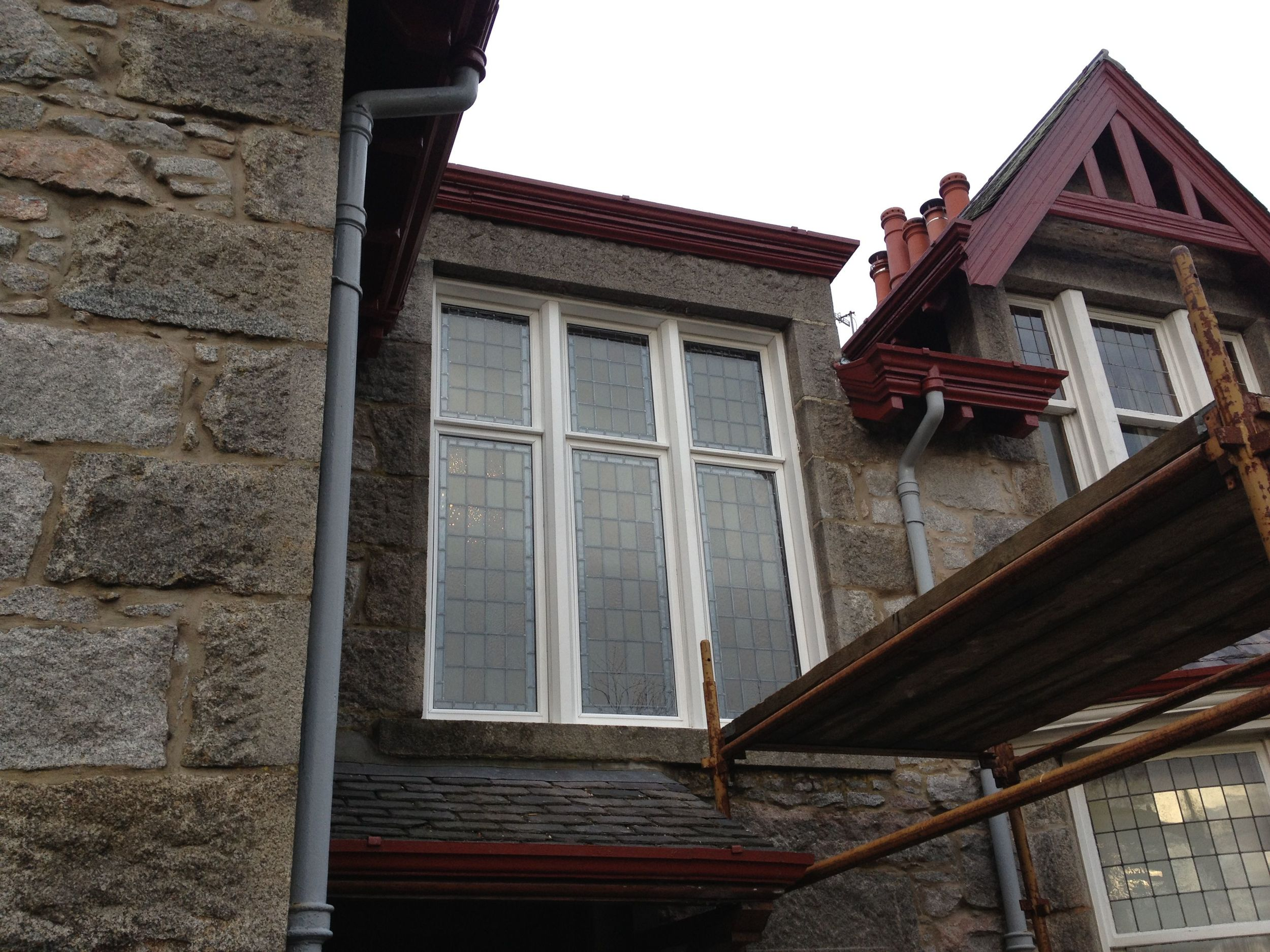Encapsulated stained glass panels (external, during installation)
