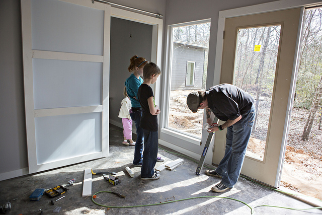 "puttying holes for painting, plus see our sliding ""barn door"" style doors? cool huh?  =)"