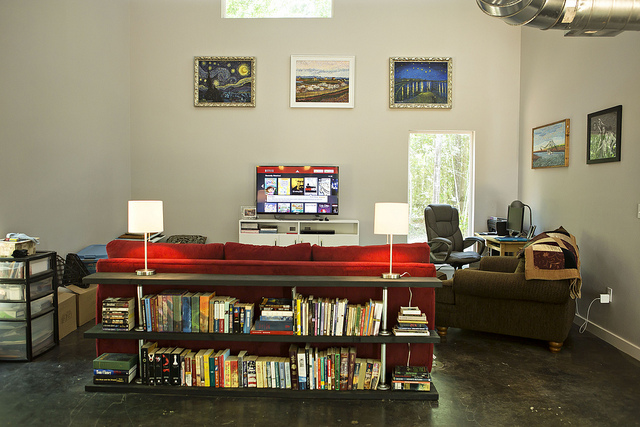another view of the livingroom, plus our awesome industrial book shelf.  (oops there are still boxes in the corner!!) =)