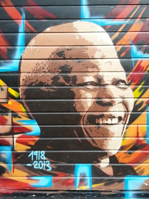 Street mural tribute to Nelson Mandela in Amsterdam's Dam Square area