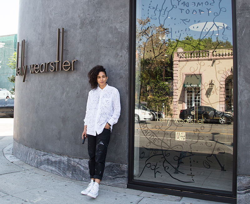 Courtesy of the artist. Shantell Martin next to her mural at the Kelly Wearstler boutique.