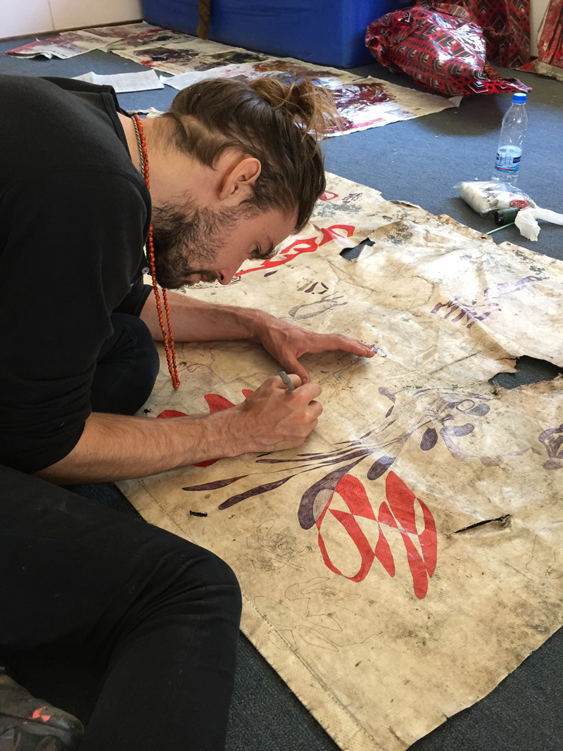 Artist Justin Orvis Steimer completing a work. He exhibited in the Fall of 2014. Courtesy of the Catinca Tabacaru Gallery.