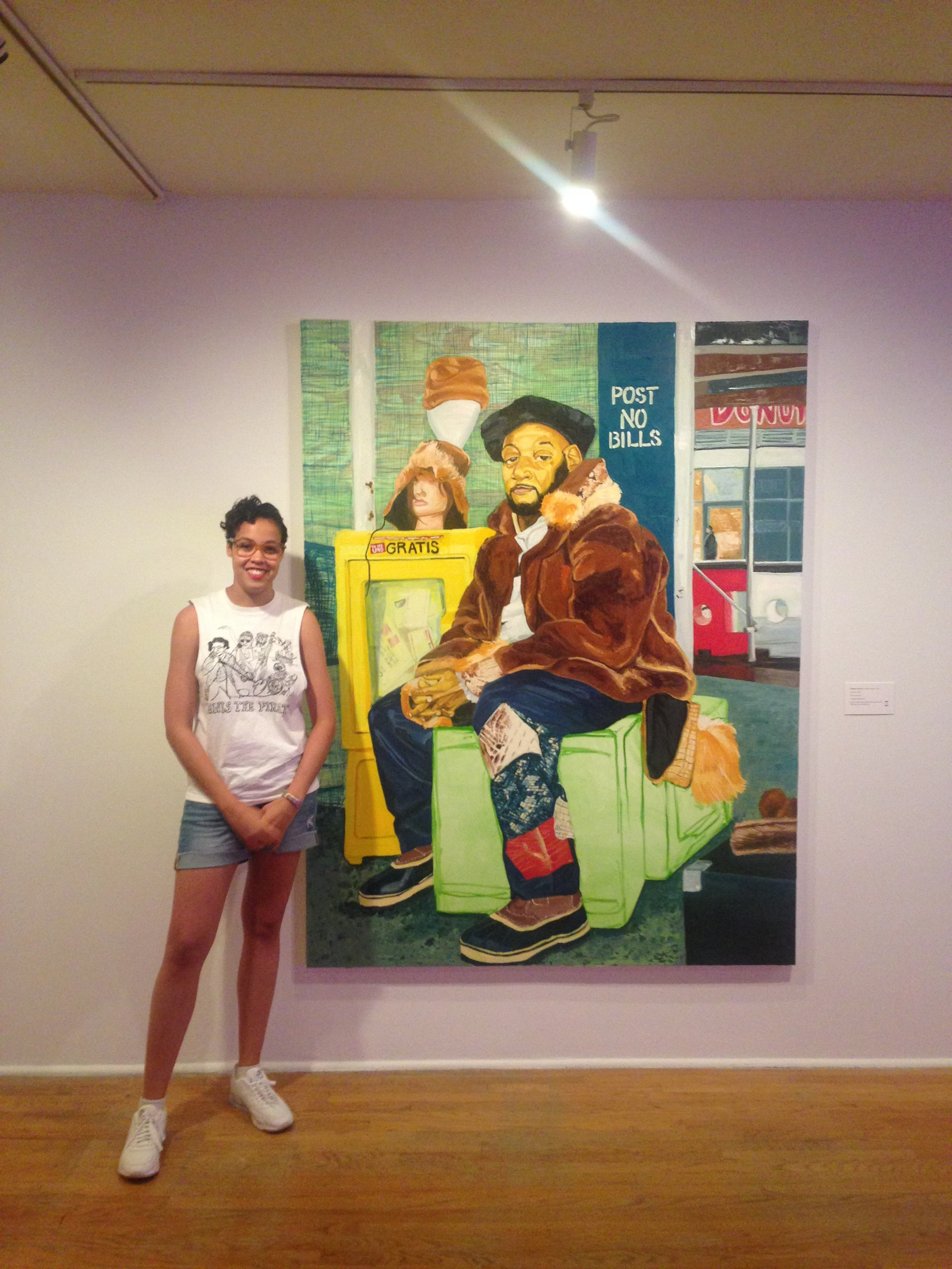 Jordan Casteel stands in front of her work 'Charles', at The Studio Museum in Harlem,August 2016.