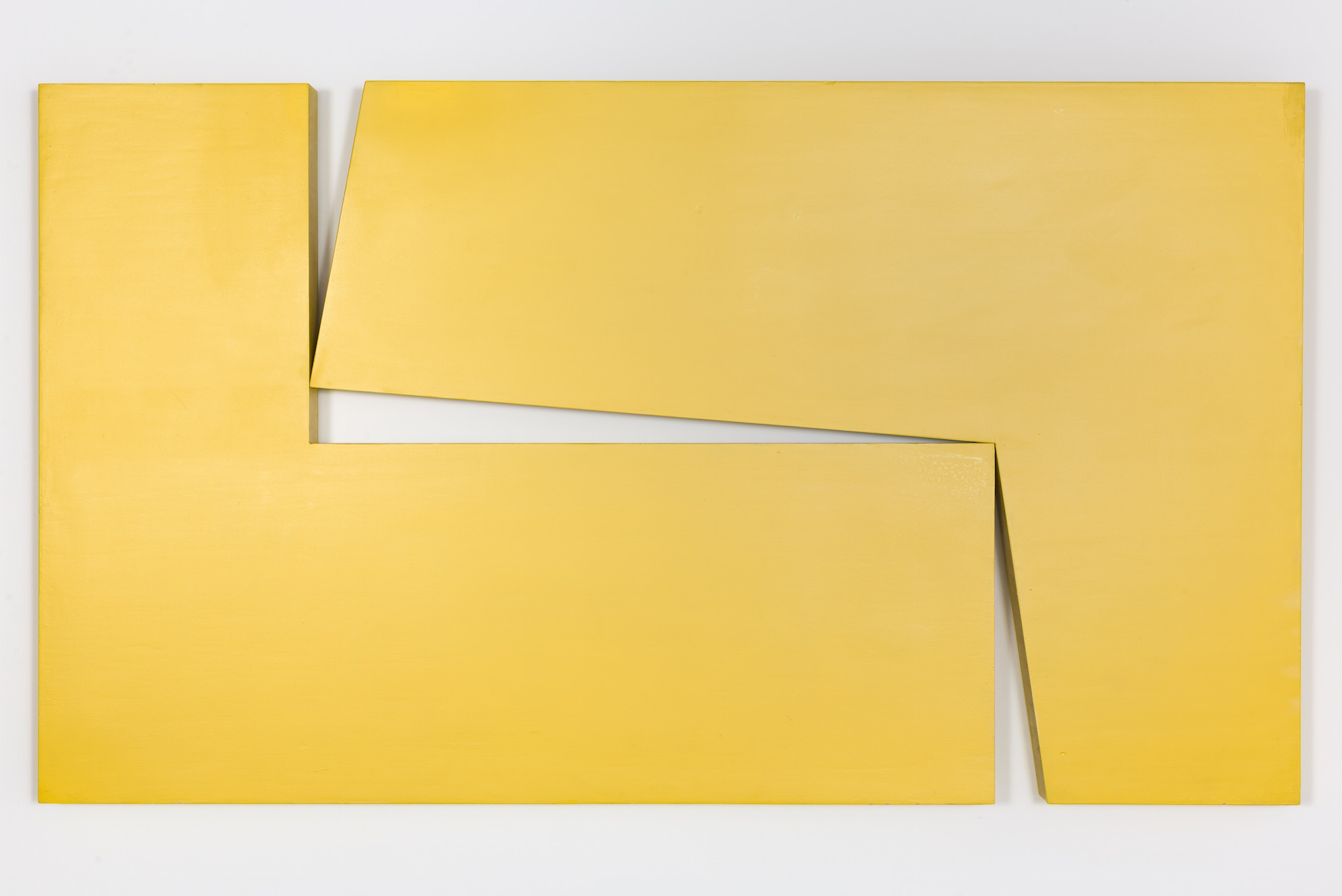 "Carmen Herrera, Amarillo ""Dos"", 1971. Acrylic on wood, 40 x 70 x 3 1/4 in. (101.6 x 177.8 x 8.3 cm). Maria Graciela and Luis Alfonso Oberto Collection © Carmen Herrera"