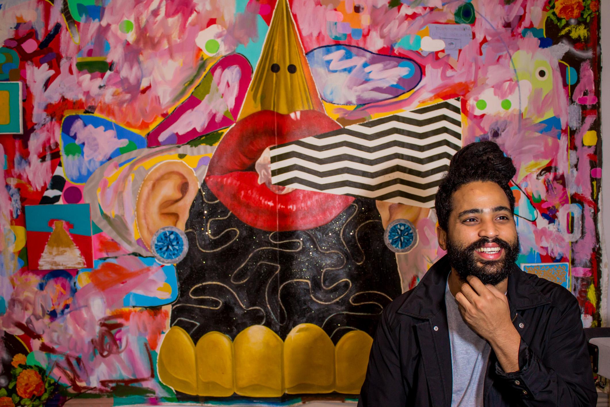Baéz in front of a work by José Delgado Zúñiga, in Washington Heights, NYC, 2019. Portrait by Magdiel Báez.