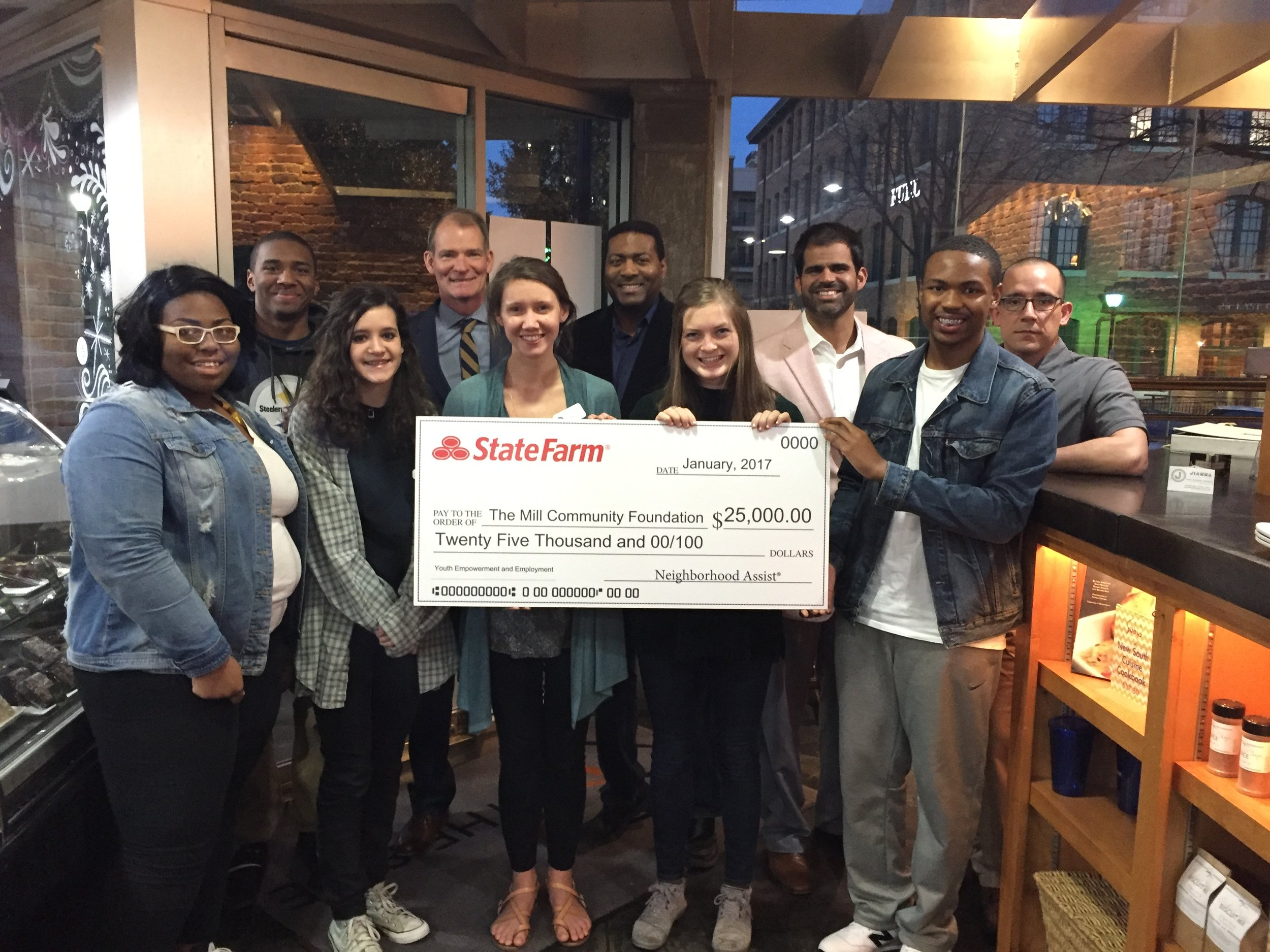 State Farm check presentation at our Youth Job Training Program at Table 301's Soby's on the Side.