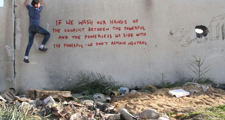 banksy gaza quote neutral powerless