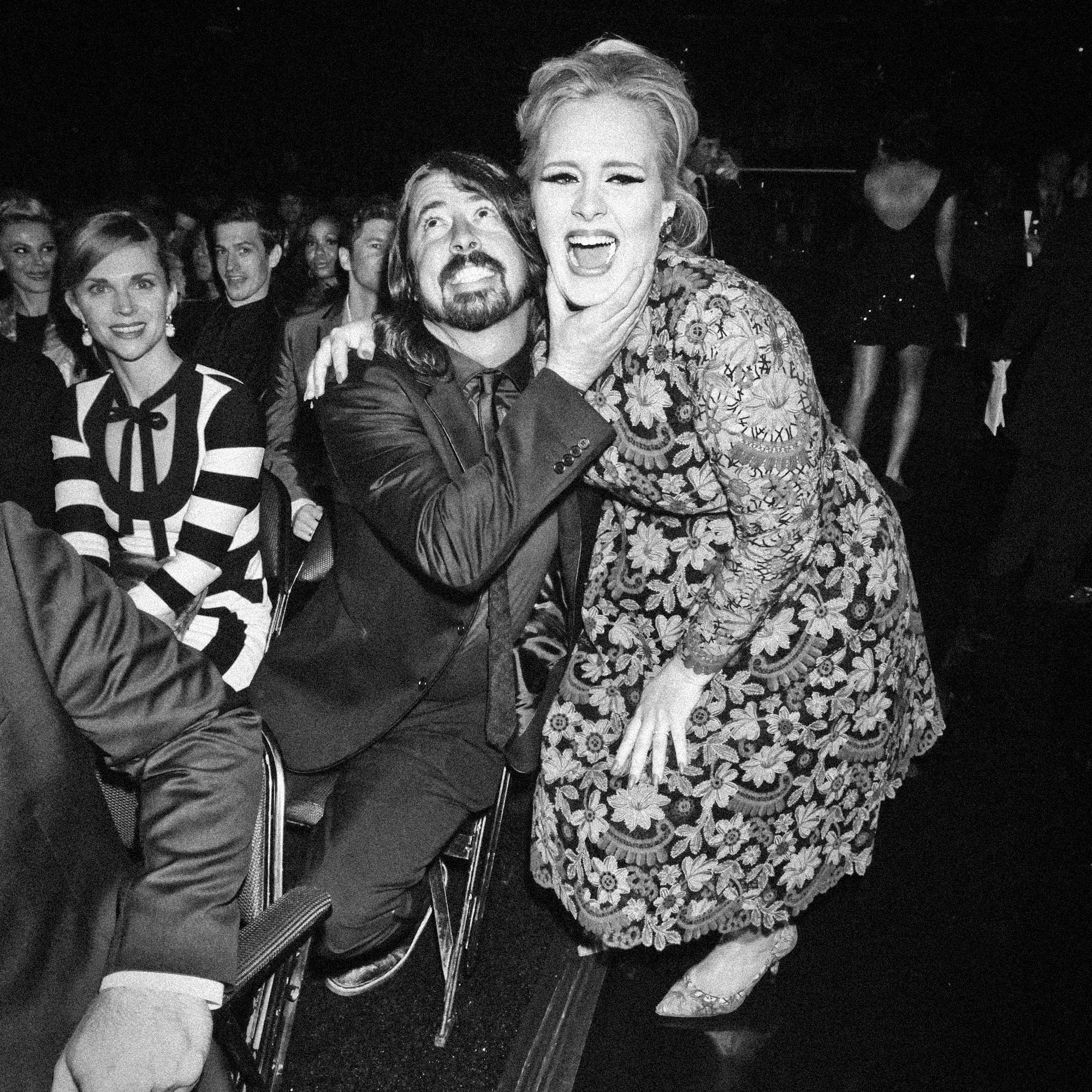 Adele gets squeezed by Dave Grohl