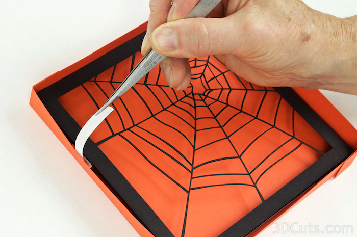 I place layer 2 inside frame 3 and use tweezers to reach in and pul the backing of the Scor-Tape in place. I then press the sides together. (Note I made 1 sample with frame 3 being orange. I switched to all layers being black for others. I like the black back best.