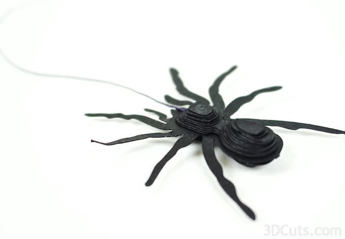 Here is the spider with the string attached and all the layers glued in place.