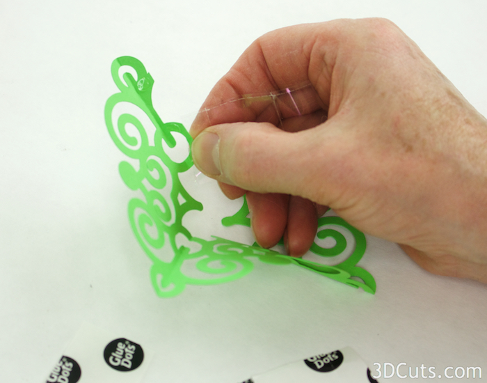 For this curly design I used a few glue dots on the tab. If you reduce size, you may want to cut the glue dots in half.