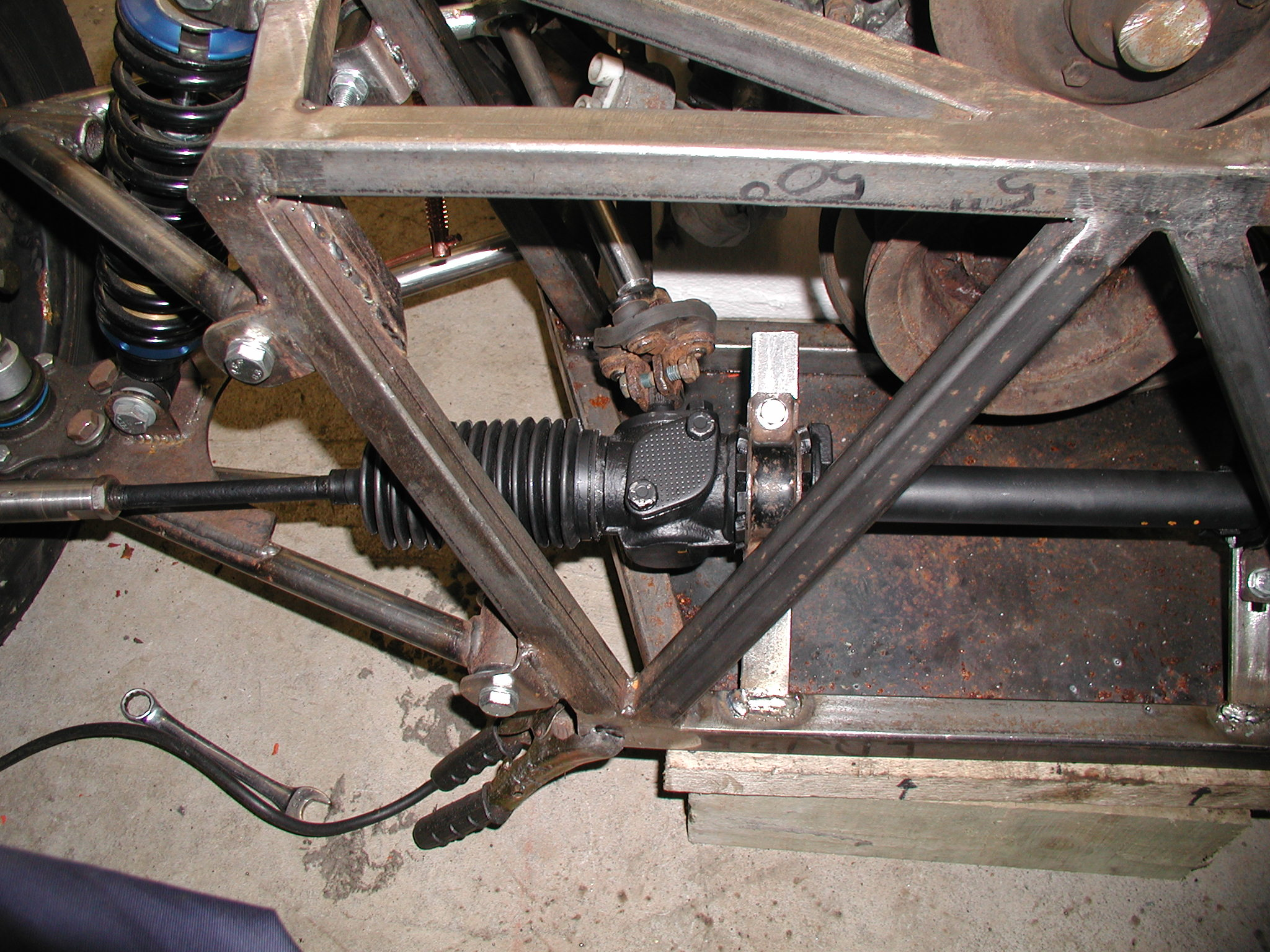Here you can see the steering rack in position and the brackets welded at the front. I still need to stiffen this with additional support once I've set the position correctly. The brackets have slots for fine adjustment to eliminate potential bump steer. This shouldn't be a big problem as the Escort MK2 rack is only 6 mm short of ideal on my chassis and I can adjust out any problems that this may give.