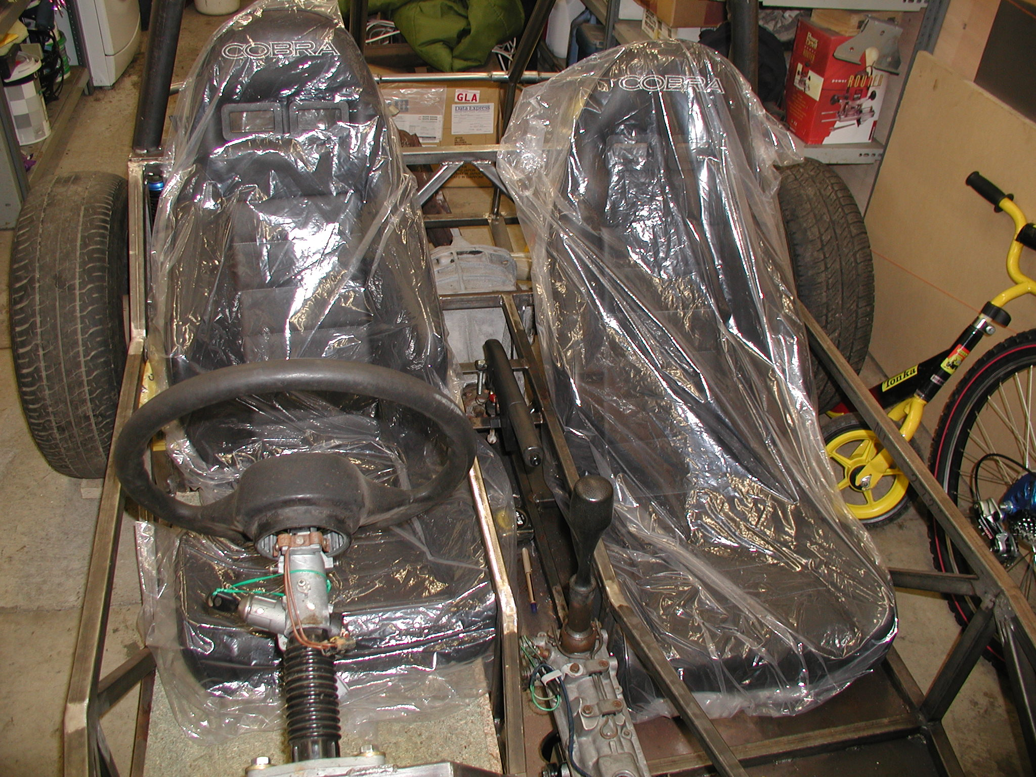 My Cobra Roadster 7 seats all wrapped up in polythene. I also cover them in an old sleeping back for protection until I have finished fitting everything around them, then they will be going up into the attic for safe keeping... I got these from Motorspeed in Ayr who were the cheapest in this area.