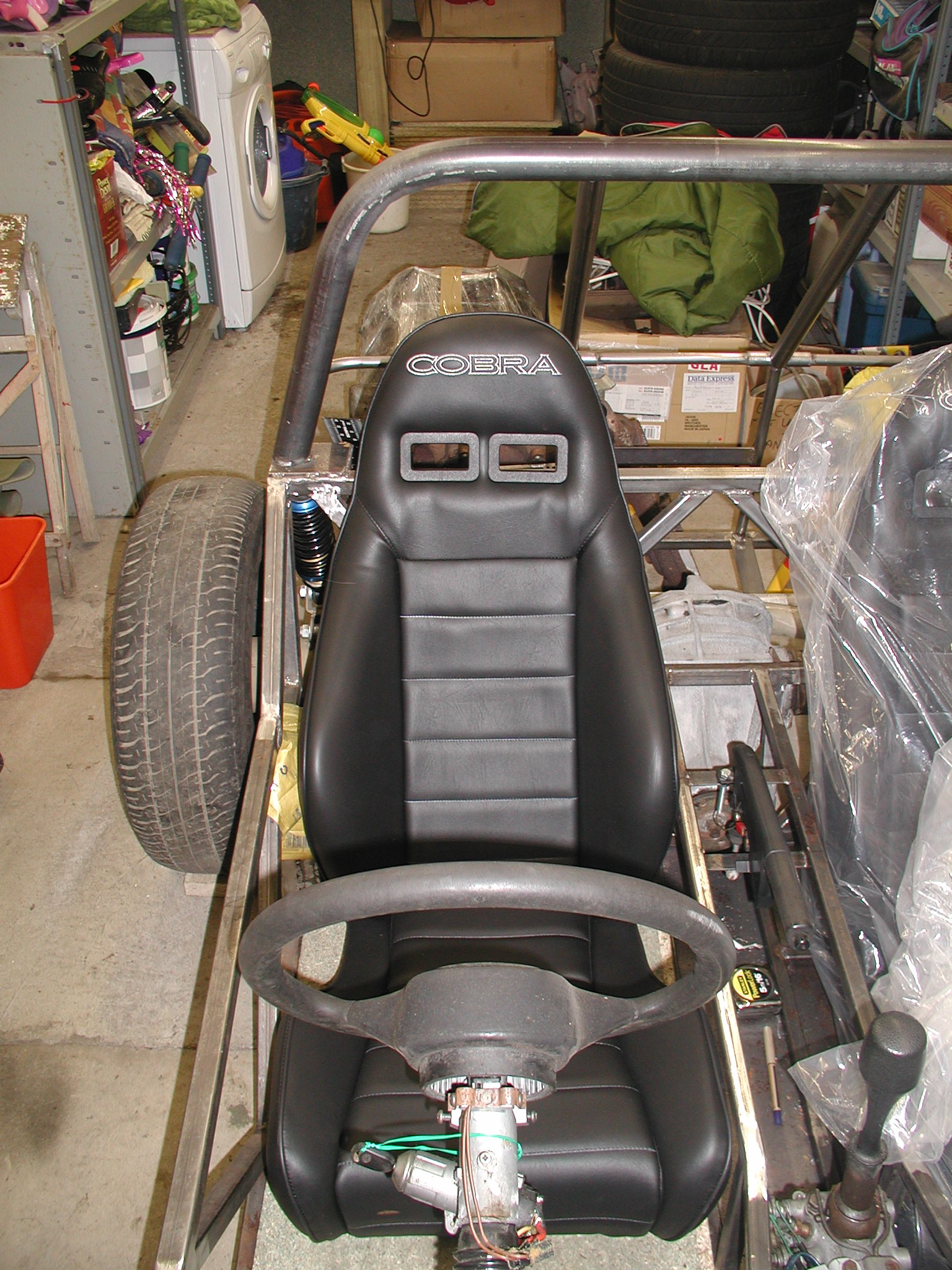 "Here's one with the cover removed. They are a very narrow seat but are very comfortable and give excellent support. I have ample space in my +4"" chassis and they will fit in standard chassis' too."