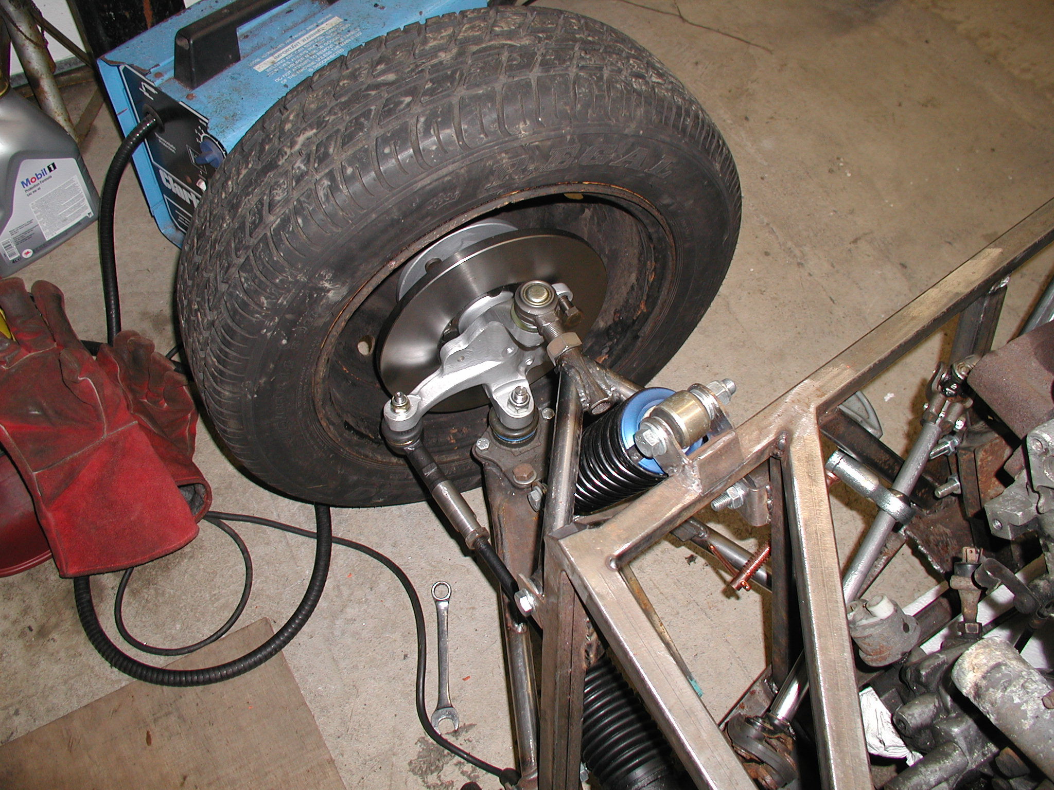 A picture of my offside hub assembly now that it has been reconditioned. New wheel bearings fitted, new disc fitted, hub de-rusted and painted. I used the electrolysis process to remove the rust and this was extremely effective. I'll write more about this at a later date.