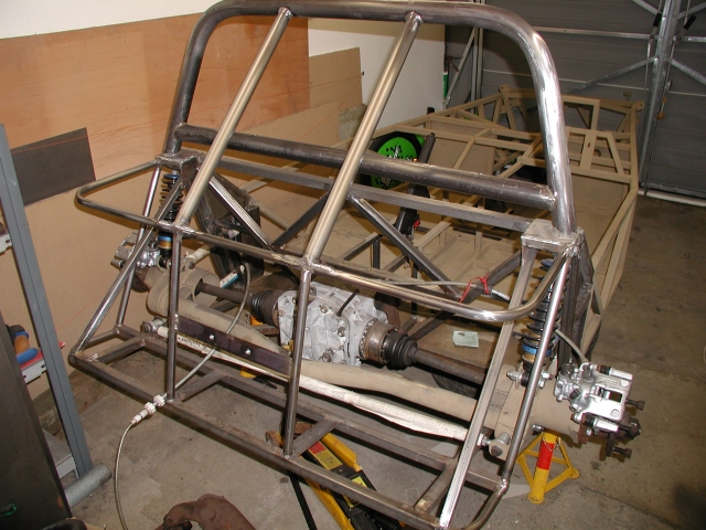 Here are a few pics of my rear calipers assembled onto the chassis for the purpose of handbrake cable routing. I've not fully decided how to route this yet but it shouldn't be a problem. I need to rebuild the hub assemblies next as they are still all rusty and need new seals and driveshaft nuts fitted.