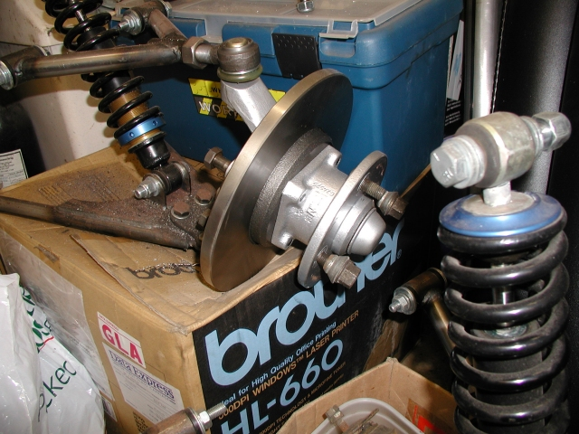 While everything is disassembled I just wanted to show you the difference between an old upright and a reconditioned upright complete with new disc and bearings. I used the electrolysis process to remove all the old paint and rust before painting with smootherite silver. Quite a difference eh? Now I'll need to do the other one...