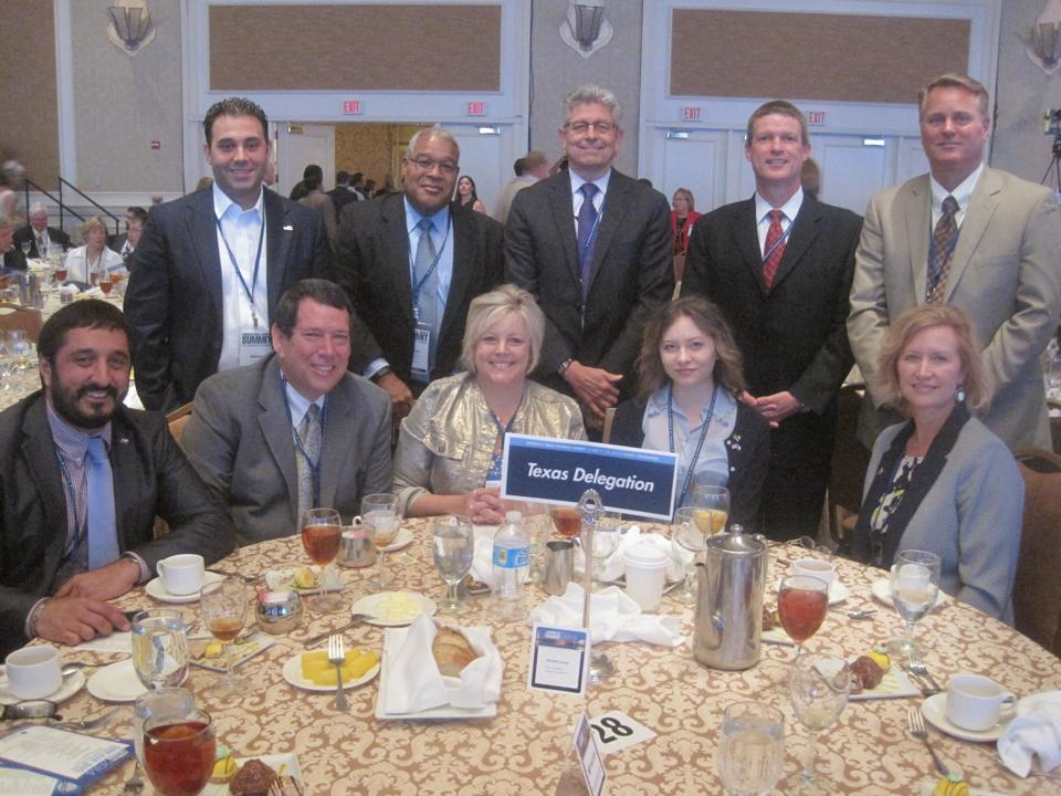 Members of the Irving Texas Delegation at the Dream Big Small Business of the Year Awards luncheon include (top row) – Blue Ribbon Winner Adrian De Leon – La Margarita Restaurant, Blue Ribbon Winner Michael Christopher - Elemental Methods,  Michael Gonzales – Chairman of the Chamber Board and President of Armstrong Relocation, and Blue Ribbon Winner Steve Wedler and Cary Albert – MATsolutions, (seated) Amir Mirabi – Director of Small Business Office for Governor Rick Perry, Blue Ribbon Winner Chuck and Karen Cooperstein – Cooksey Communications, and Blue Ribbon Winner Kiana and Jo Ann Goin – Glory House Catering.