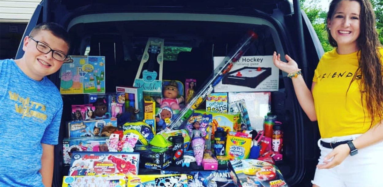 2018 Rogers Scholar Kennedy Bruner of Garrard County collects toy donations for the Wyatt's Warriors Toy Chests at the University of Kentucky Children's Hospital for her community service project. The toys were donated at an end-of-the-school-year celebration planned and organized by the Garrard County High School student.