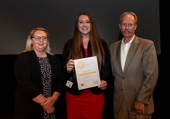 Lonnie Lawson, President and CEO of The Center for Rural Development, and Allison Cross, Community Liaison and Youth Programs Coordinator for The Center, present 2019 ELI graduate Kennedy Bruner with a certificate for completing the program. Bruner is a student at Garrard County High School.