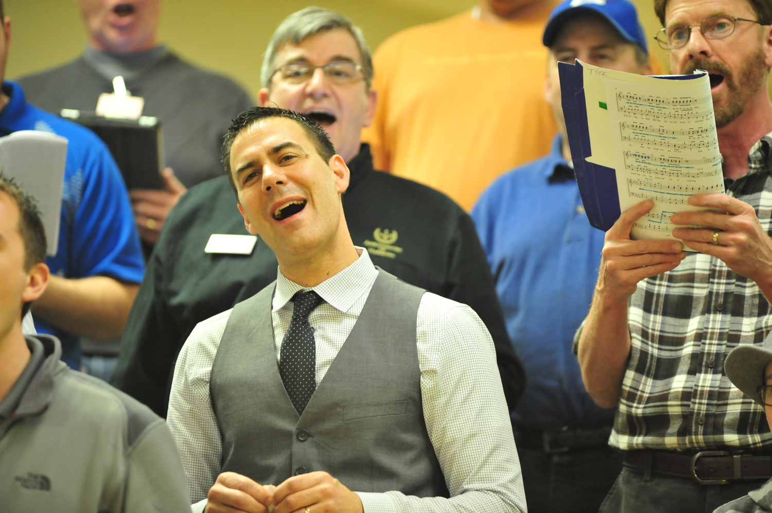 Gene Spilker, a baritone and tenor (yup!), presentation judge and member of the chorus' visual team, sings during a recent rehearsal. (Photo by Joel Currier)