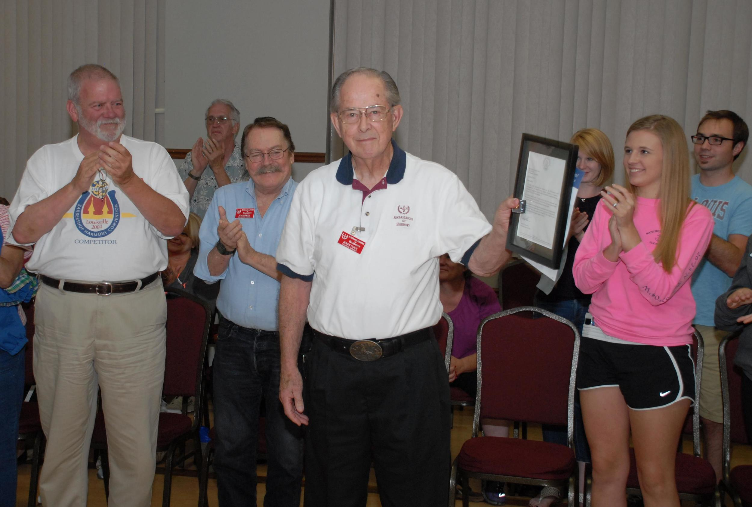 Jerry Coen, founding member of the Ambassadors of Harmony, receives his 50-year pin and certificate on Oct. 10. Photo by Bob Griesedieck