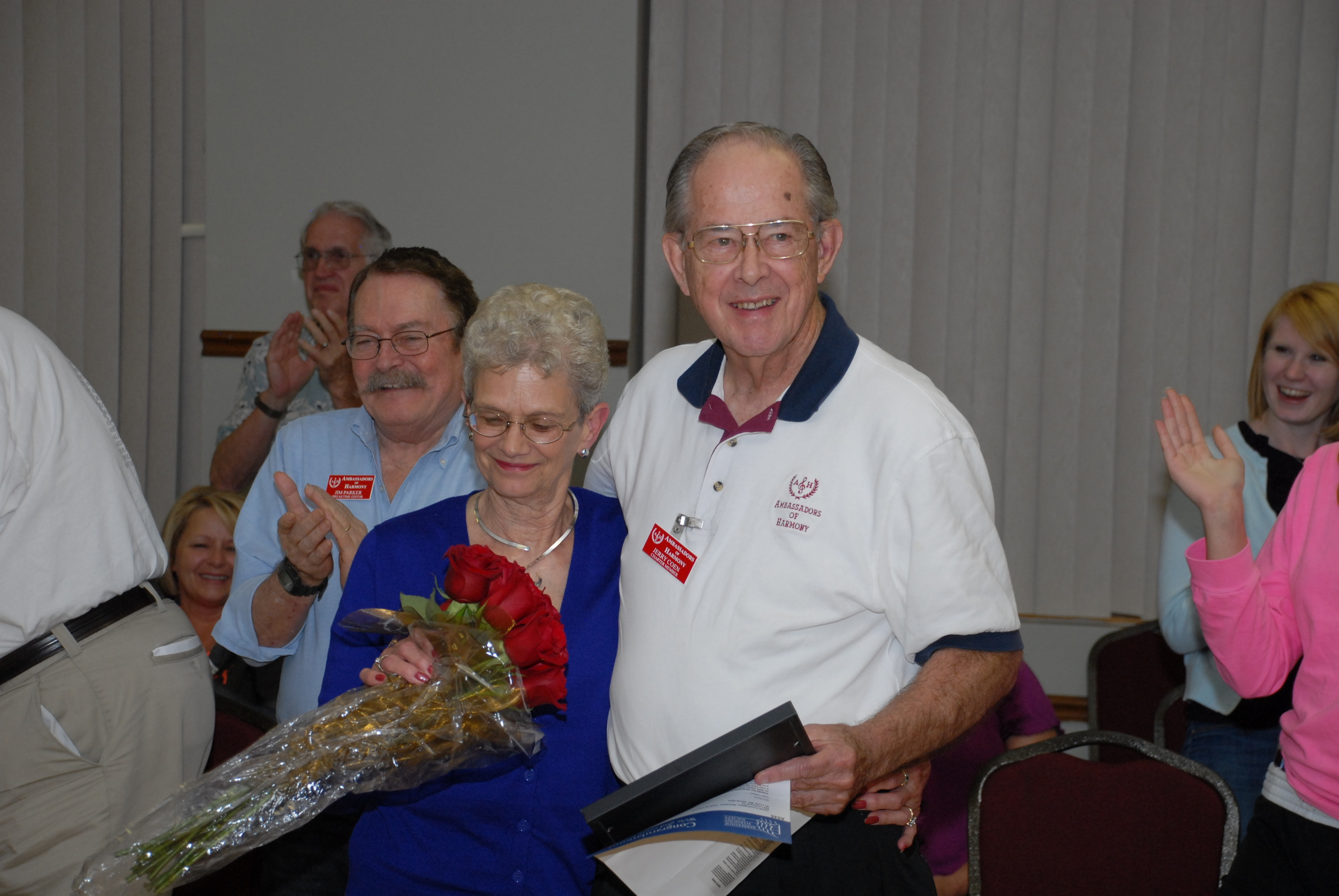 Shirley Coen, left, joins her husband, Jerry, as he receives a 50-year pin and letter congratulating five decades of membership in the Ambassadors of Harmony. Photo by Bob Griesedieck