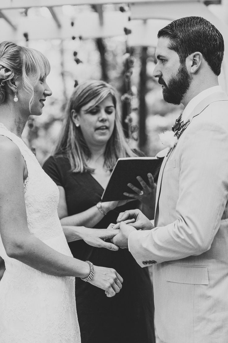 When should we hire our wedding officiant? | photo by  Henry + Mac Photography