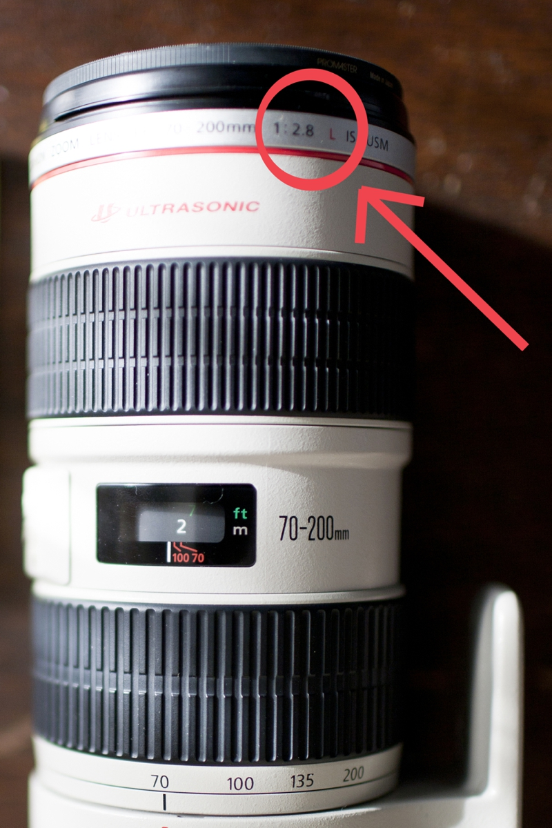 After your lens' size (aka ##mm) you will see this ratio, and the number after the colon is the widest your lens opens. So in the case of my 70-200mm lens it is 2.8