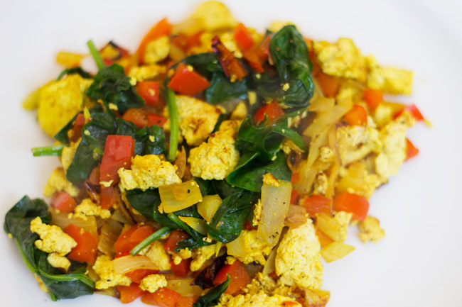with spinach, red peppers and onion