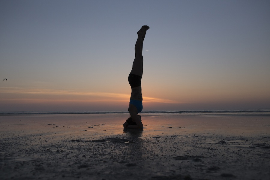 headstand at sunrise