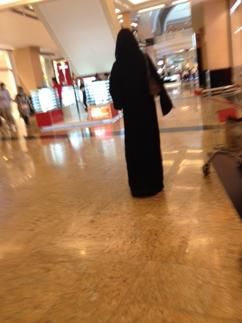 woman in traditional dress at the mall
