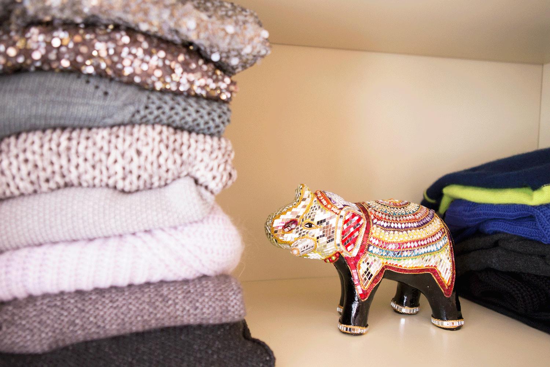 Fall sweaters & an elephant I got on  my trip to India .