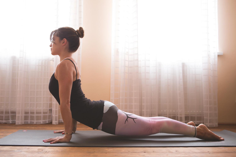 Why does your back hurt in sun salutations?  Wearing:  Teeki pants . Using:  Black mat pro .