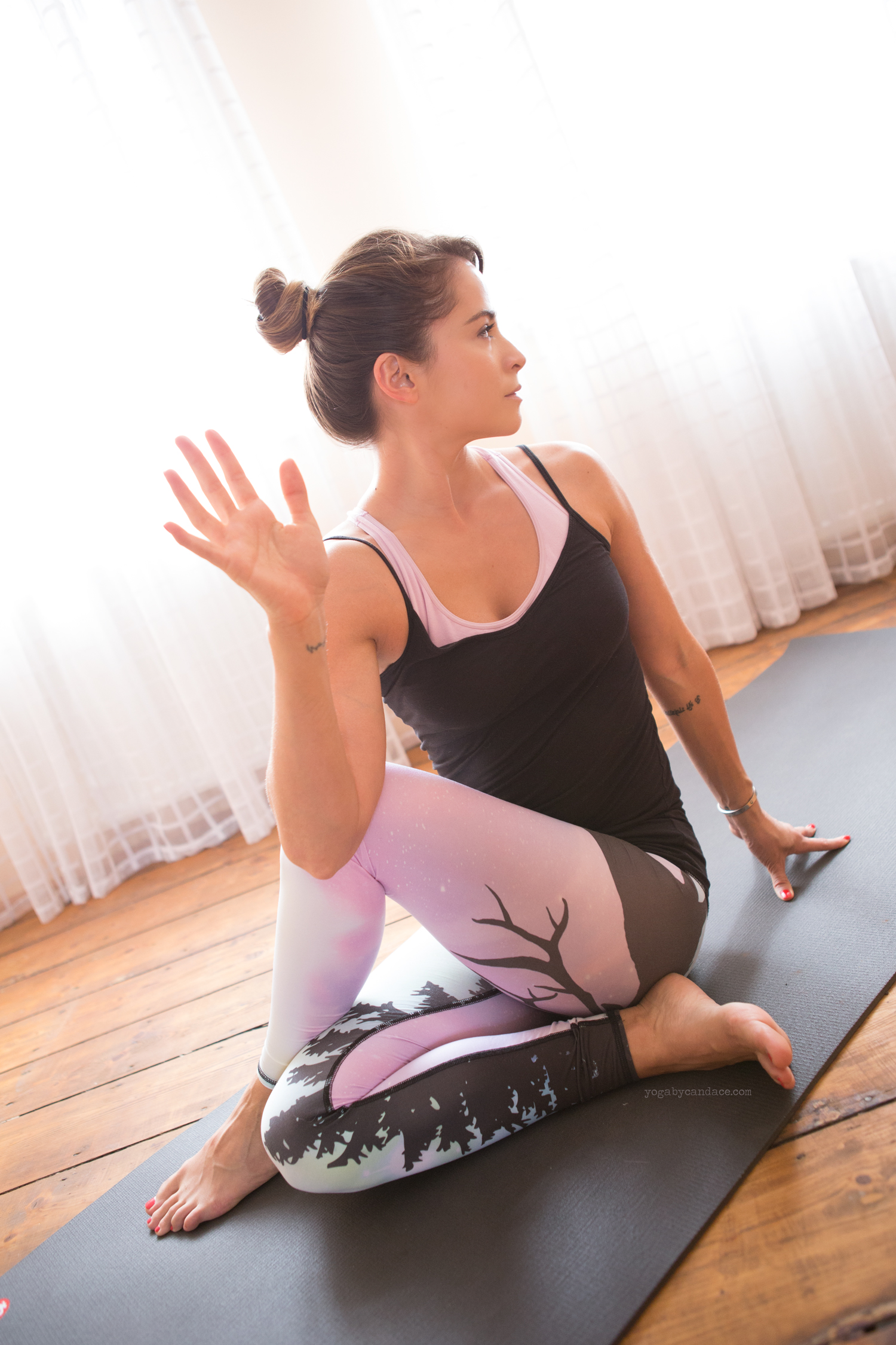 Seated twist - good stretch for the back of the hips and torso.   Wearing:  Teeki pants  . Using:  Black mat pro  .