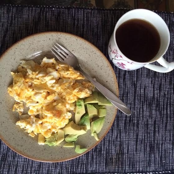 Typical breakfast - 4 eggs, half an avocado,  tea .