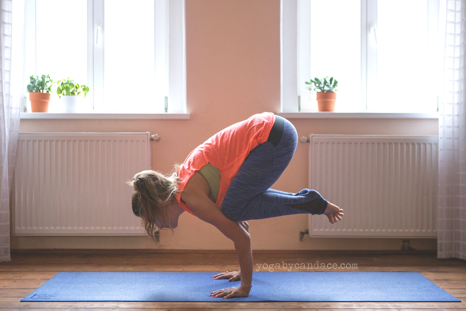 Crow pose wearing  Sweaty Betty leggings  and  top  c/o.