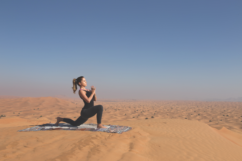 Low lunge in the Arabian desert  Wearing:  forever 21 leggings ,  splendid tank .