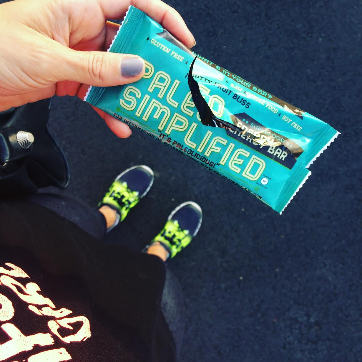 Off to the gym  Wearing:  reebok sneakers ,  sweaty betty capris . Eating:  Paleo Simplified bar .