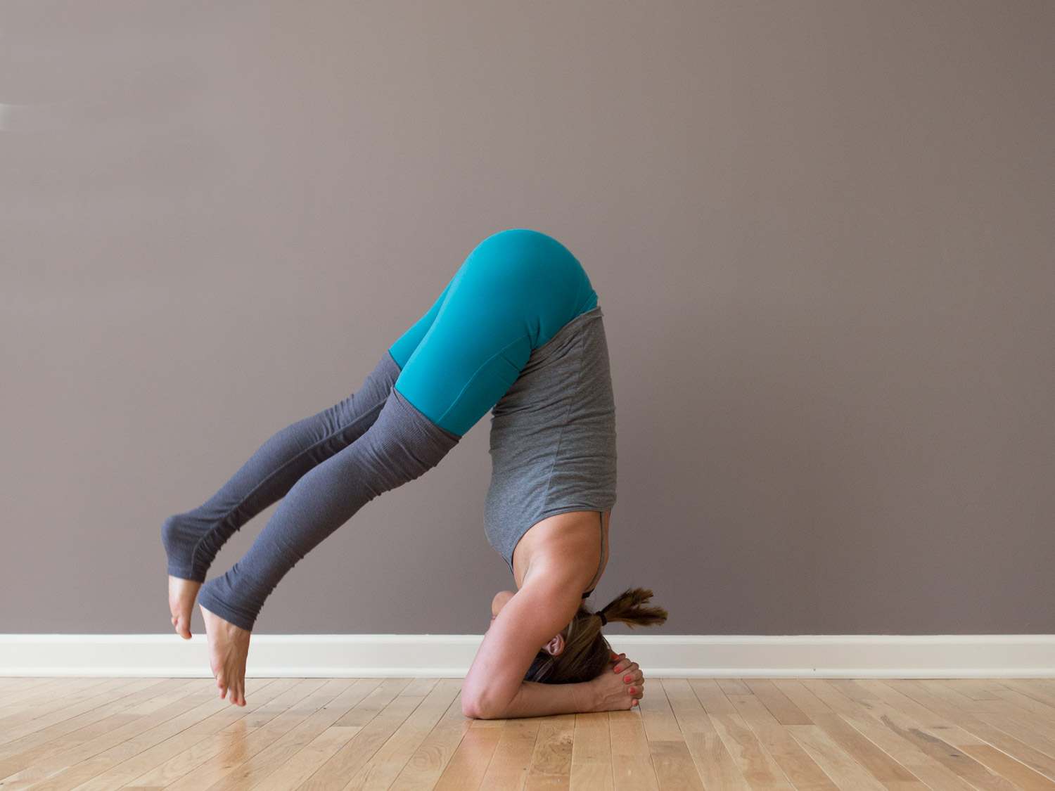 Funky transitions - headstand to forearm stand  Wearing:  alo yoga pants