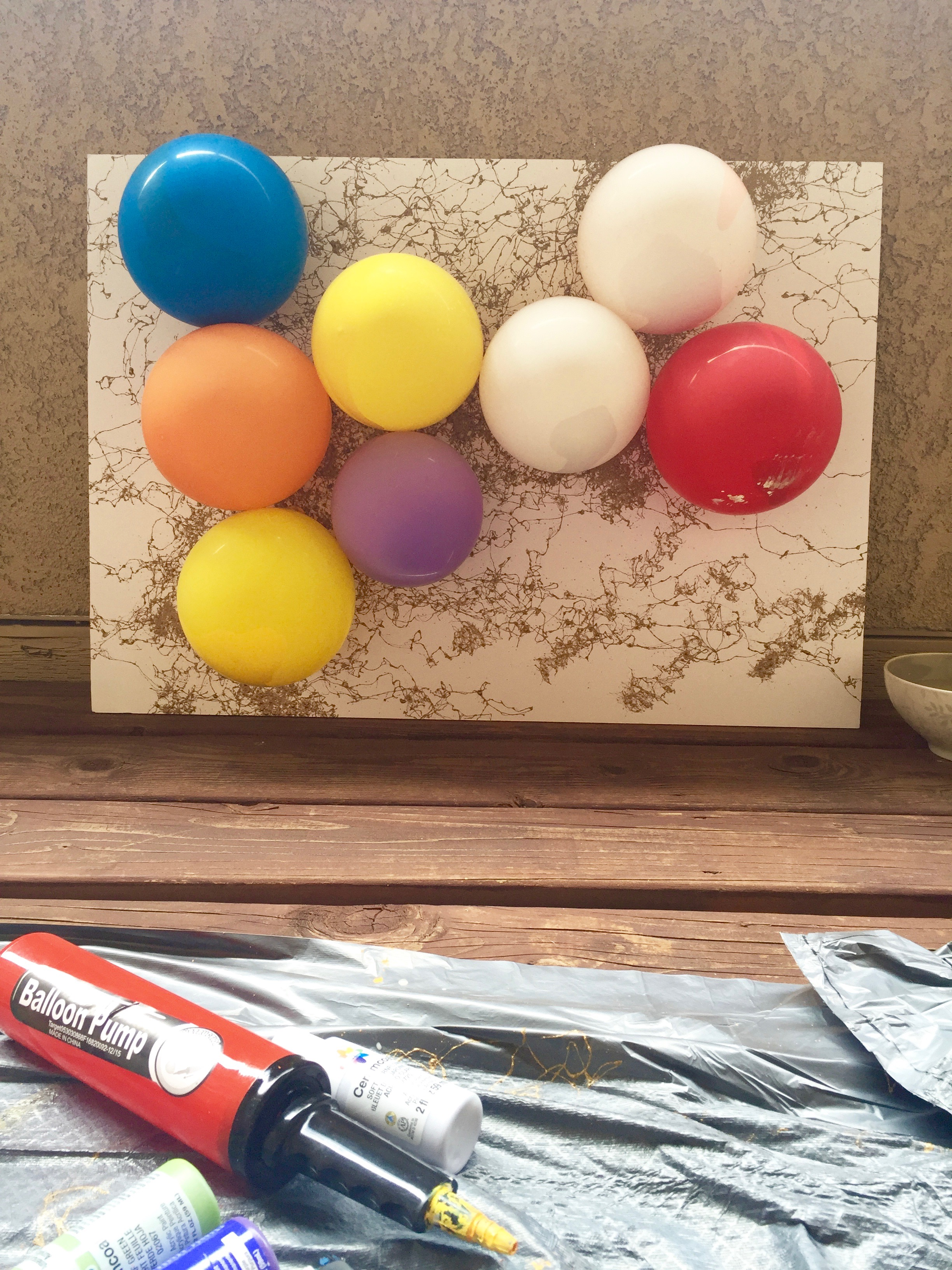 DIY Balloon Abstract Art II Step Four, secure balloons to canvas